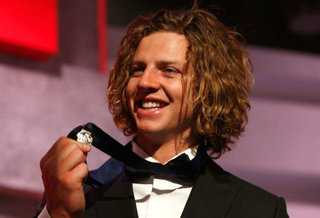MELBOURNE, AUSTRALIA - SEPTEMBER 28: 2015 Brownlow Medalist, Nat Fyfe of the Dockers poses for a photograph during the 2015 Brownlow Medal count at the Crown Palladium, Melbourne, Australia on September 28, 2015. (Photo by Michael Willson/AFL Media)